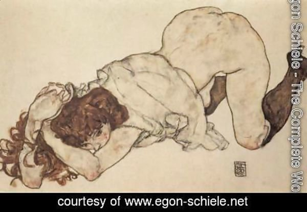 Egon Schiele - Kneeling girl, on both elbows supported