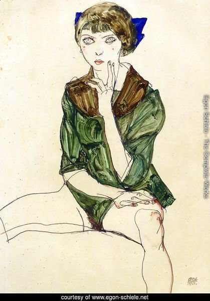 Sitting Woman in a Green Blouse